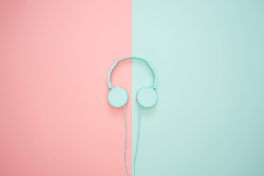 Blue headphones on blue and pink background